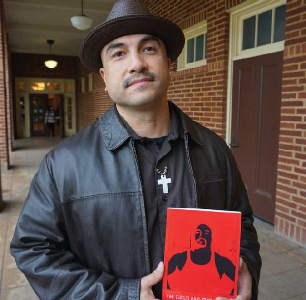 Instructor Chacon holding his book