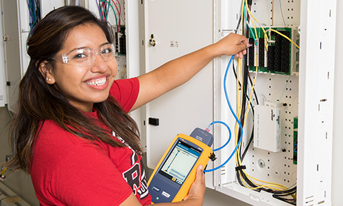 Student with electrical systems