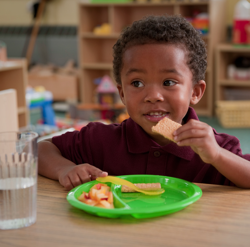 Preschool child eating snack