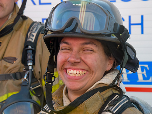 smiling woman firefighter
