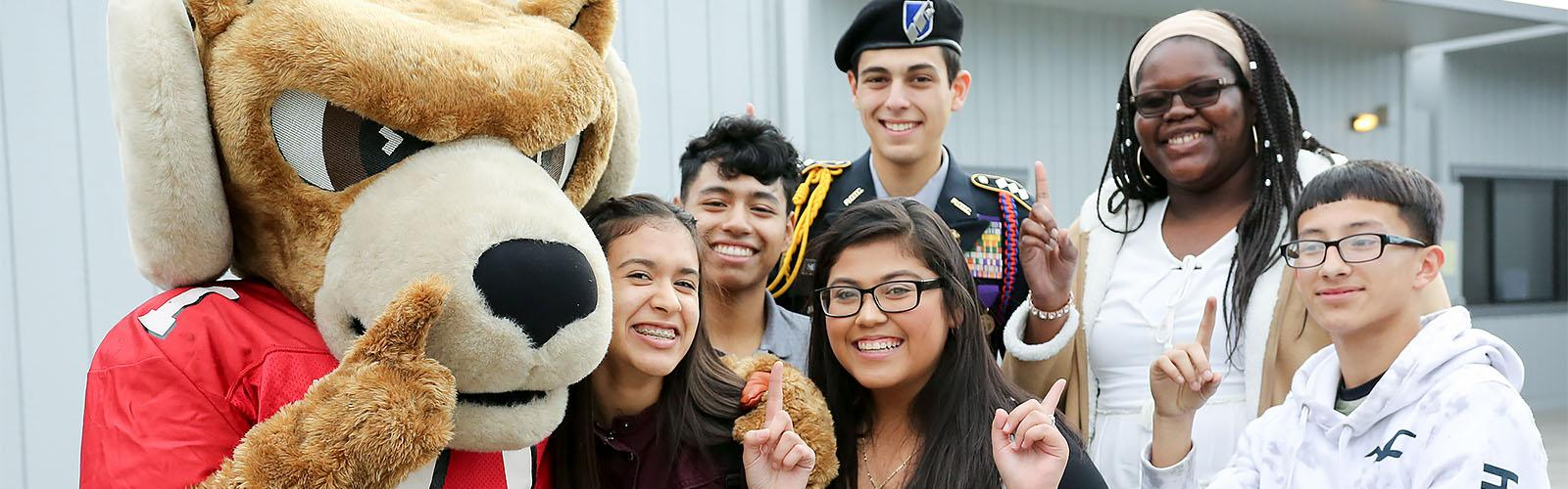 Smiling students with Rocky the Ram mascot